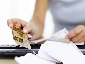 woman reading receipts and holding a credit card